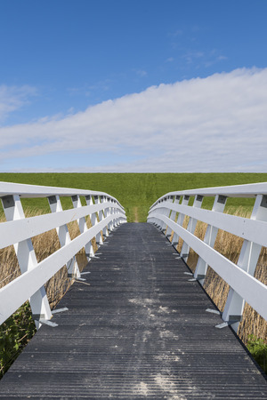 friesland: White, wooden hikers and bicycle bridge in Friesland in the Netherlands.