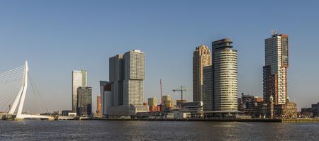 Wilhelminapier in Rotterdam with skycrapers, offices, Erasmus Bridge and Hotel New York. 에디토리얼