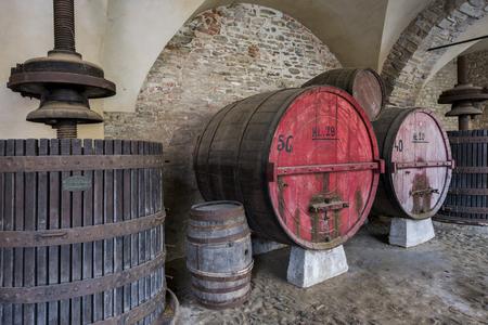 winepress: Wine barrel and winepress in Monastero Bormida in Piedmont, Italy Stock Photo