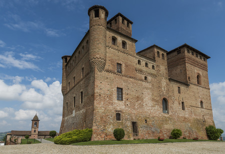 cavour: Grinzane Cavour, Italy - May 30, 2016: Wine Castle Grinzane Cavour and Church in  Piedmont in Barolo district in Italy.
