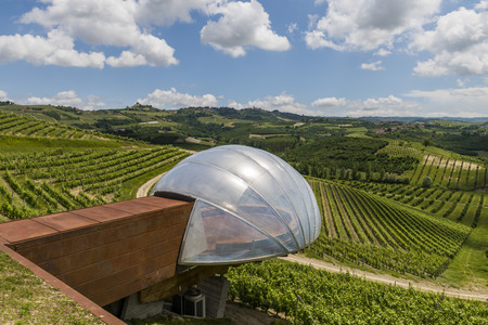 Alba, Italy - May 30, 2016: Ceretto Winery with view point,  vineyards and hills in Piedmont, Italy.