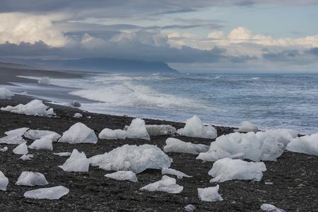 climatology: Ice blocks at the beach in the evening near river Jokulsa at Jokulsarlon glacier lagoon in the Vatnajokull National Park, Iceland.