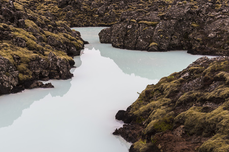 blue lagoon: Pool with blue water in the Blue Lagoon in Iceland with lava and volcanic rocks.