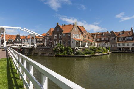 Old houses and draw bridge in the center of Enkhuizen, The Netherlands.