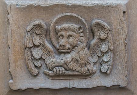 evangelist: The lion on the church door of Walluf in Germany symbol for evangelist Marcus.