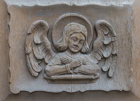 evangelist: The human on the church door of Walluf in Germany symbol for evangelist Mattheus. Stock Photo