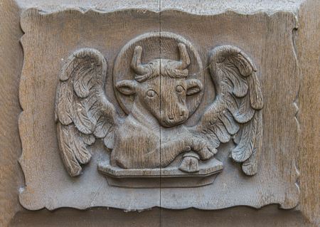 lucas: The bull on the church door of Walluf in Germany symbol for evangelist Lucas.