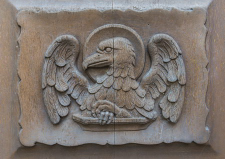 johannes: The eagle on the church door of Walluf in Germany symbol for evangelist Johannes. Stock Photo