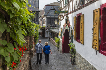Rudesheim, Germany - August 20,2016: Drosselgasse with tourists in Rudesheim near the river Rhine.