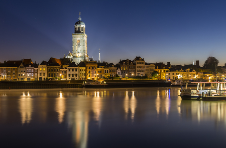 ijssel: Deventer at the IJssel in the morning during blue hour with the Great Church or Lebuinuskerk in the province Overijssel, The Netherlands.