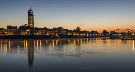 morning blue hour: Deventer at the IJssel in the morning during blue hour with the Great Church or Lebuinukerk and Bridge in the province Overijssel, The Netherlands.