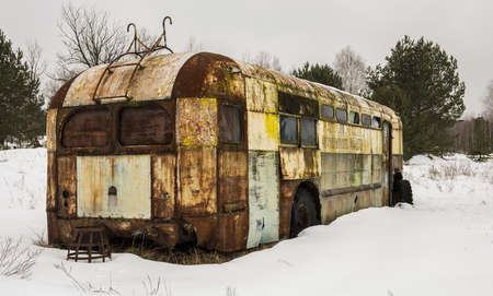 Rusty metal caravan in Chernobyl in the Exclusion zone in the Ukraine in wintertime. Stock Photo