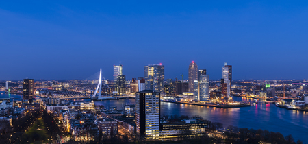 Rotterdam, The Netherlands - March 24, 2017:  Panorama taken from the Euromast in the Netherlands with Erasmus bridge, offices, skyscrapers, river Nieuwe Maas and city centre.