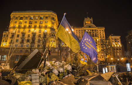 Kiev, Ukraine - February 26, 2014:  Barricades with tires and flags in Kiev on Maidan Square during the revolution in the Ukraine. Editorial