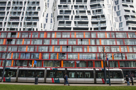 achitectural: Rotterdam, The Netherlands - March 10, 2017: Calypso Achitectural Building with RET tram in front in Rotterdam city, the Netherlands Editorial