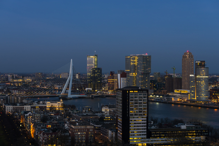 Rotterdam taken from the Euromast in the Netherlands with Erasmus bridge, offices, skyscrapers, river Nieuwe Maas and city centre.