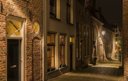 Deventer, The Netherlands - December 17, 2016: Bergkerkplein (street) in Deventer during Christmas time in the evening with christmas lights and  lanterns during Dickens Festival.