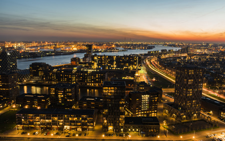 Rotterdam, The Netherlands - March 24, 2017: Nieuwe Maas in Evening Light with ships on the river, industrial areas and the harbor of Rotterdam in the Netherlands. Editorial