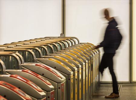 Arnhem, The Netherlands - December 23, 2016: OV -chip gates for NS and Arriva at railway station Arnhem with shops.