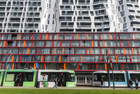 achitectural: Rotterdam, The Netherlands - March 10, 2017: Calypso Achitectural Building with two trams in front in Rotterdam city, the Netherlands
