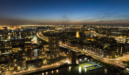 Rotterdam, The Netherlands - March 24, 2017: Panorama taken from the Euromast in the Netherlands with offices, buildings, houses, traffic and sunset.