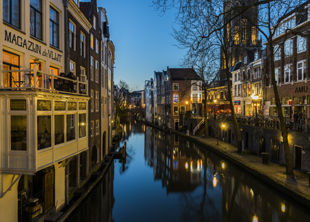 Utrecht, The Netherlands - March 27, 2017: Oude Gracht at night with the Dom (church) and canal, restaurants and monumental houses. Editorial