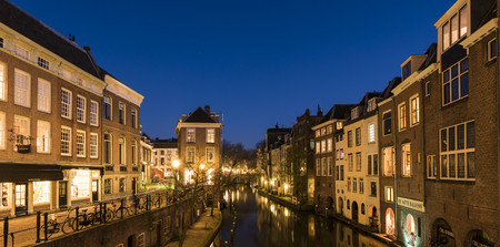 Utrecht, The Netherlands - March 27, 2017: Oude Gracht at night with canal, restaurants and monumental houses.