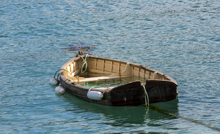 Cornish rowing boat almost sunk in the harbor of Saint Ives, Cornwall, England.