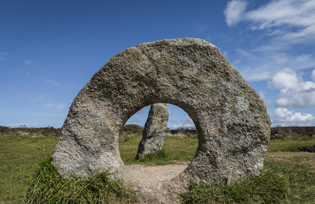 Stone Circle Men-an-Tol with three standing stones on a meadow in Cornwall, England.