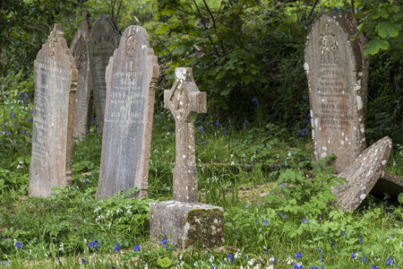 Ludgvan, England - April 28, 2017: Cemetery of Saint Paul Ludgvan in Cornwall with gravestones and grave tomb.