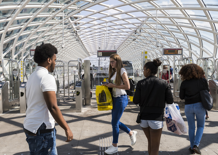 The Hague, The Netherlands - August 6, 2017: Central Train Station The Hague with travellers at the HTM tram metro station. Publikacyjne