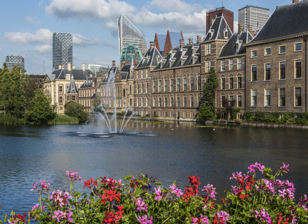 the hague: The Hague, The Netherlands - August 6, 2017: Parliament buildings, museum Mauritshuis, skyscrapers and the Torentje of prime minister of the Netherlands, in front the pond the Hofvijver.