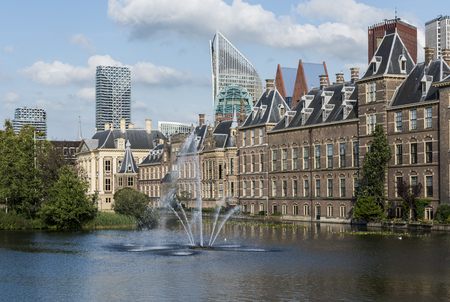 The Hague, The Netherlands - August 6, 2017: Parliament buildings, museum Mauritshuis, skyscrapers and the Torentje of prime minister of the Netherlands, in front the pond the Hofvijver.