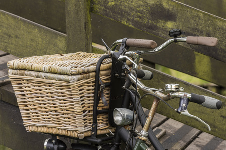 Two old Dutch bikes with wicker basket on the stering wheel.