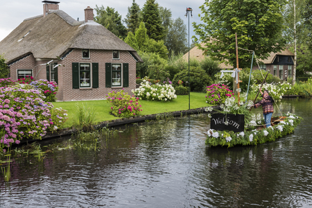 Jonen, The Netherlands - July 30, 2016:  Welcome boat of the Gondelvaart  in the small, picturesque town of Jonen near Giethoorn, Overijssel, Netherlands. Editorial