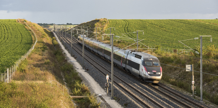 Reims, France - September 12, 2017: the high speed train of France, the TGV of the SNCF, at great speed in the evening.