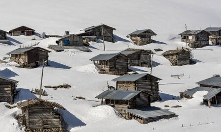 Koprulu, Turkey - May 9, 2019: Small village of Koprulu in the snow with wooden houses and cabins in a snowy valley in Turkey. Redactioneel