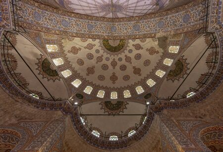 Istanbul, Turkey - April 29, 2019: Colorful ceiling of the old famous islamic Blue Mosk in Istanbul, Turkey. Redactioneel