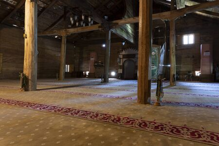 Carsamba, Turkey - May 4, 2019: Wooden interior of the old wooden mosk Gogcelli Camii in Turkey. Redactioneel