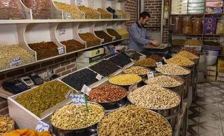 Tabriz, Iran - May 12, 2019: Great Bazaar in Tabriz with man in a nuts shop at the market, Iran. Redactioneel