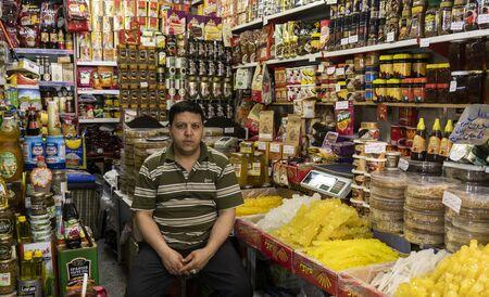 Tabriz, Iran - May 12, 2019: Great Bazaar in Tabriz with man in a food shop at the market, Iran.