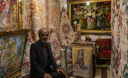 Tabriz, Iran - May 12, 2019: Great Bazaar in Tabriz with man in a painting shop at the market, Iran. Redactioneel