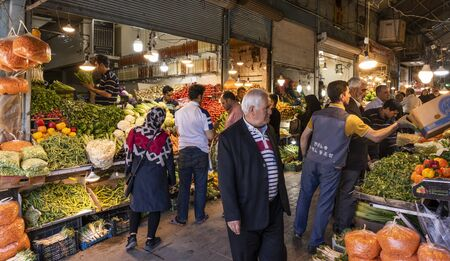 Tabriz, Iran - May 12, 2019: Great Bazaar in Tabriz with people at a vegetable and food shop at the market, Iran.