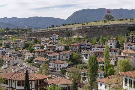Safranbolu, Turkey - May 1, 2019:  Touristic village with typical Turkish white houses and turkish flag.