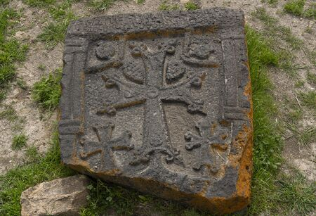 Ani, Turkey - May 9, 2019: Ruins of the old Armenian town Ani with carved stone with star, Turkey. Redactioneel