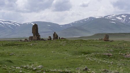 Ani, Turkey - May 9, 2019: Ruins of the old Armenian town Ani with snowy mountains in the background, Turkey.