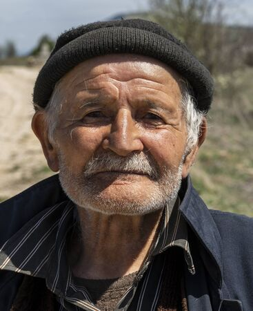 Deresoplan, Turkey - May 1, 2019: Old, characteristic turkish man with black cap and moustache. Redactioneel