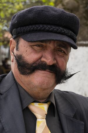 Sinop, Tukey - May 3, 2019: Portret of Tukish man with a big moustache and black hat.