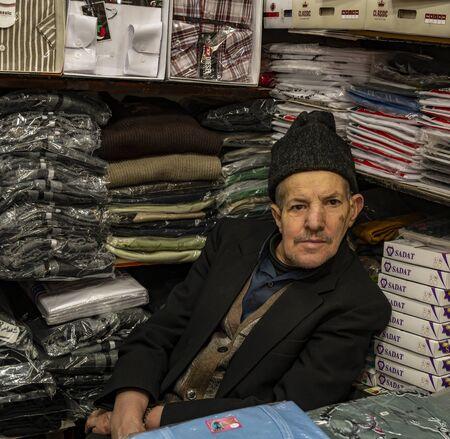 Tabriz, Iran - May 12, 2019: Great Bazaar in Tabriz with man with had in a shop at the market, Iran. Redactioneel