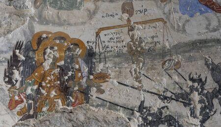 Vazelon, Turkey - May 6, 2019: Fresco of portrait of  Saints and devils at the destroyed and abandoned monastery of Vazelon, Turkey.